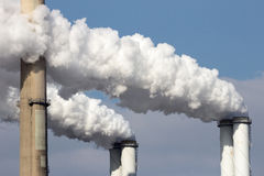 Factory smoke. Smoke emission from factory pipes Royalty Free Stock Images