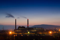 Factory smoke at night Royalty Free Stock Photography