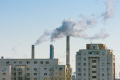 Factory smoke polluting the air Royalty Free Stock Images