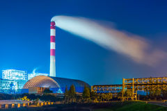 Factory With Smoke Stack Against Sky At Night Royalty Free Stock Image