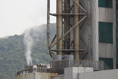 Factory  with smoke stacks at hk Stock Photo