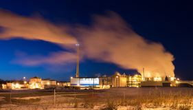 Factory with smoke stacks at twilight. Royalty Free Stock Photography