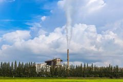 Factory smokestack on blue sky background Royalty Free Stock Images