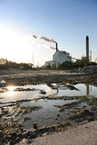 Factory With Smokestacks. And abandoned lot in foreground Royalty Free Stock Photography