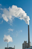 Factory with Smokestacks and Blue Sky Stock Images