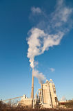 Factory with Smokestacks and Blue Sky Royalty Free Stock Photo