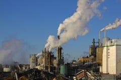 Factory Smokestacks. Polluting the environment Royalty Free Stock Images