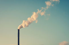 Factory with smoking chimney Royalty Free Stock Photo