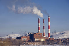 Factory with smoking chimneys. Factory building with three smoking chimneys Royalty Free Stock Photos