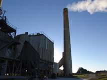 Factory with smoking chimneys. Sunny day Stock Images