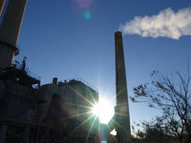 Factory with smoking chimneys. Sunny day Stock Photography