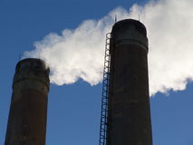 Factory with smoking chimneys. Sunny day Royalty Free Stock Photo