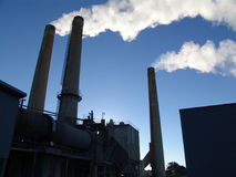 Factory with smoking chimneys. Sunny day Royalty Free Stock Photography
