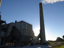 Factory with smoking chimneys. Sunny day Stock Photo