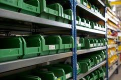 Factory stockroom shel. Factory stockroom green boxes on shel Stock Photography