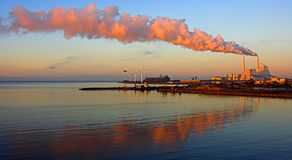 Factory in the sunrise. Factory and smoke in the danish sunrise Stock Photography