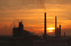 Factory sunrise. Sunrise from the oil factory royalty free stock photography