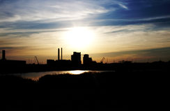 Factory in sunset. A factory in sunlight backlit Royalty Free Stock Images