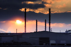 Factory and sunset Stock Images