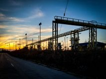 Factory and sunset. Factory, road, light, pipes, industrial, street, lights, cleveland, ohio, sunset royalty free stock image