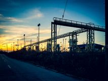 Factory and sunset. Factory, road, light, pipes, industrial, street, lights, cleveland, ohio, sunset stock photography