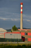 Factory in sunshine with high chimney. An factory in sunshine with high chimney Stock Photo