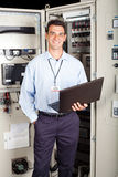 Factory technician. Portrait of modern factory technician in front of machine stock images