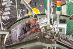 Factory technician repairing Stock Images