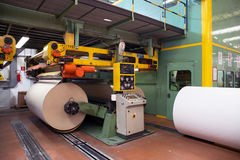 Factory to produce corrugated cardboard. Paper are delivered to corrugators, wrapped around large reels and are processed into sheets of corrugated Royalty Free Stock Photo