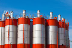 Factory towers. Three process towers in a factory stock photography