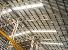 Factory truss structure with translucent roof Stock Images