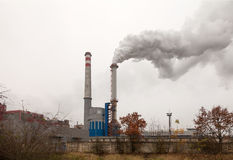 Factory, two smoking chimneys Royalty Free Stock Photos