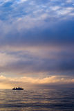 Factory vessel and sunset. Factory vessel in north atlantic fishing macrell royalty free stock photos