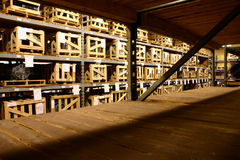 The Factory Warehouse. Crated parts awaits assembly in a factory's warehouse Stock Photography
