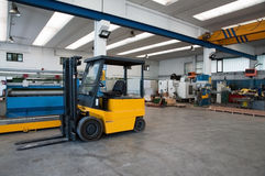Factory warehouse with forklift Stock Image