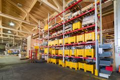 Factory warehouse steel reinforcement. large yellow plastic boxes on the shelves. royalty free stock image