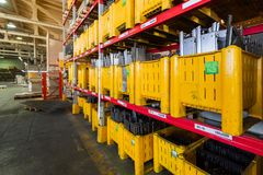 Factory warehouse steel reinforcement. large yellow plastic boxes on the shelves. stock photos