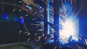 Factory welding. Industrial Robot arm. Close-up stock footage
