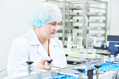 Factory woman worker operating production line Royalty Free Stock Photos