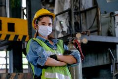 Free Factory Woman Worker Or Technician With Hygienic Mask Stand With Confident Action With Big Machine As Background Stock Images - 178314234
