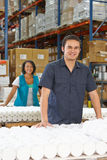 Factory Worker Checking Goods On Production Line. Smiling Stock Photography