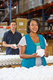 Factory Worker Checking Goods On Production Line Stock Image