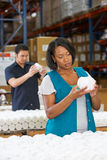 Factory Worker Checking Goods On Production Line. Concentrating Royalty Free Stock Photo