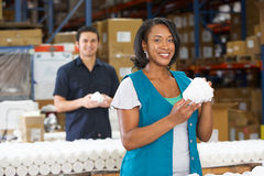Factory Worker Checking Goods On Production Line. Smiling Stock Photos