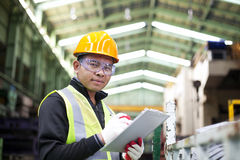 Factory worker with clipboard on the hand stock photos
