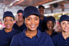 Factory worker colleagues. Happy young african factory worker with colleagues Stock Photo