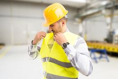 Factory worker or engineer dressing for work stock photo