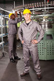 Factory worker full length. Textile factory worker full length portrait in front of machine Royalty Free Stock Image