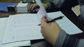 Factory worker making notes at the desk stock video