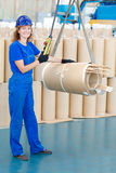 Factory worker moving transformer coil with overhead crane Stock Photo